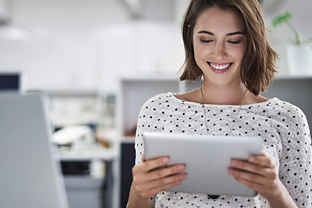 Customer - smiling woman on tablet