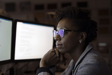 Misc - Woman with glasses looking at desktop