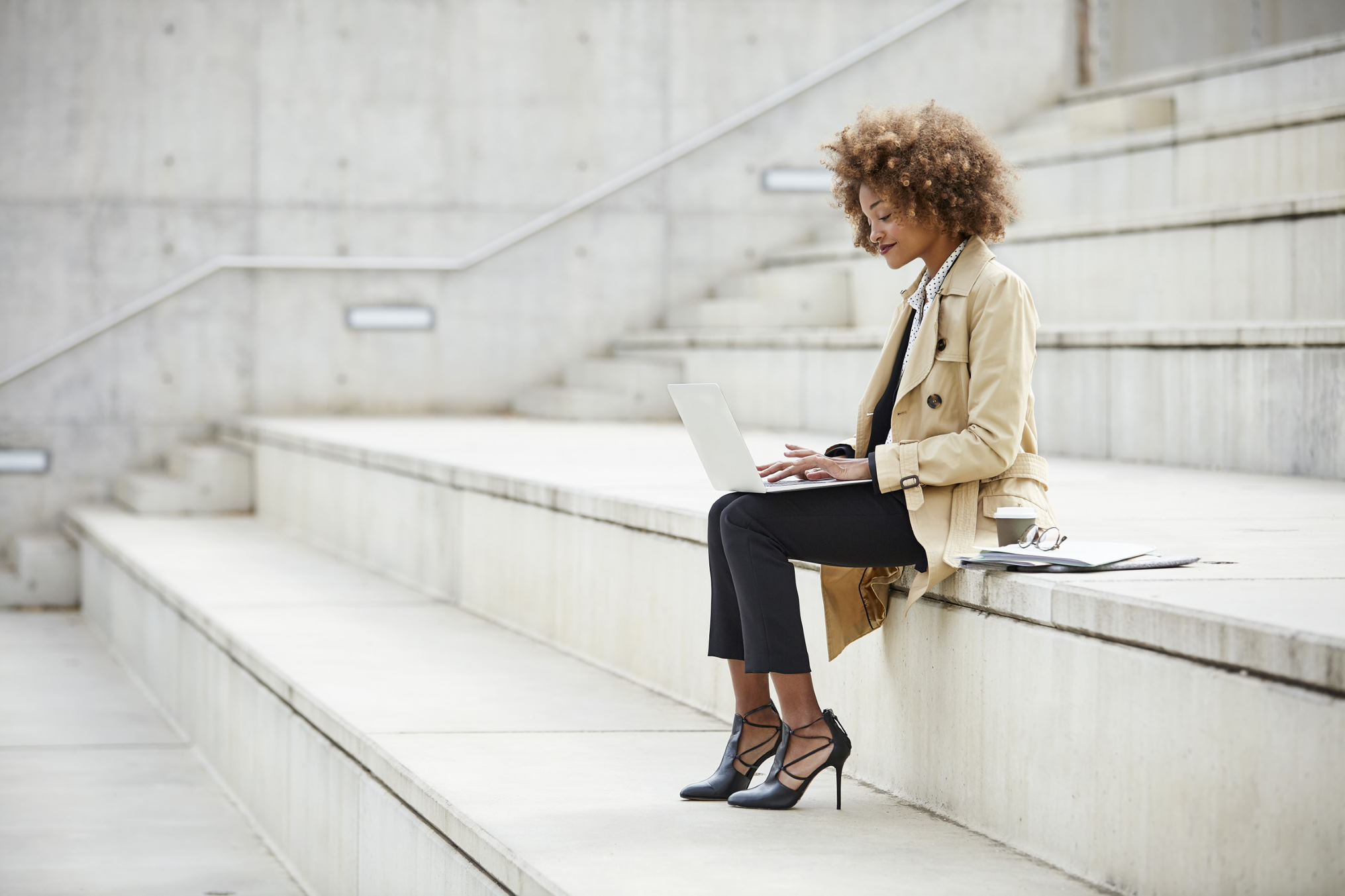 woman on the stairs with a laptop