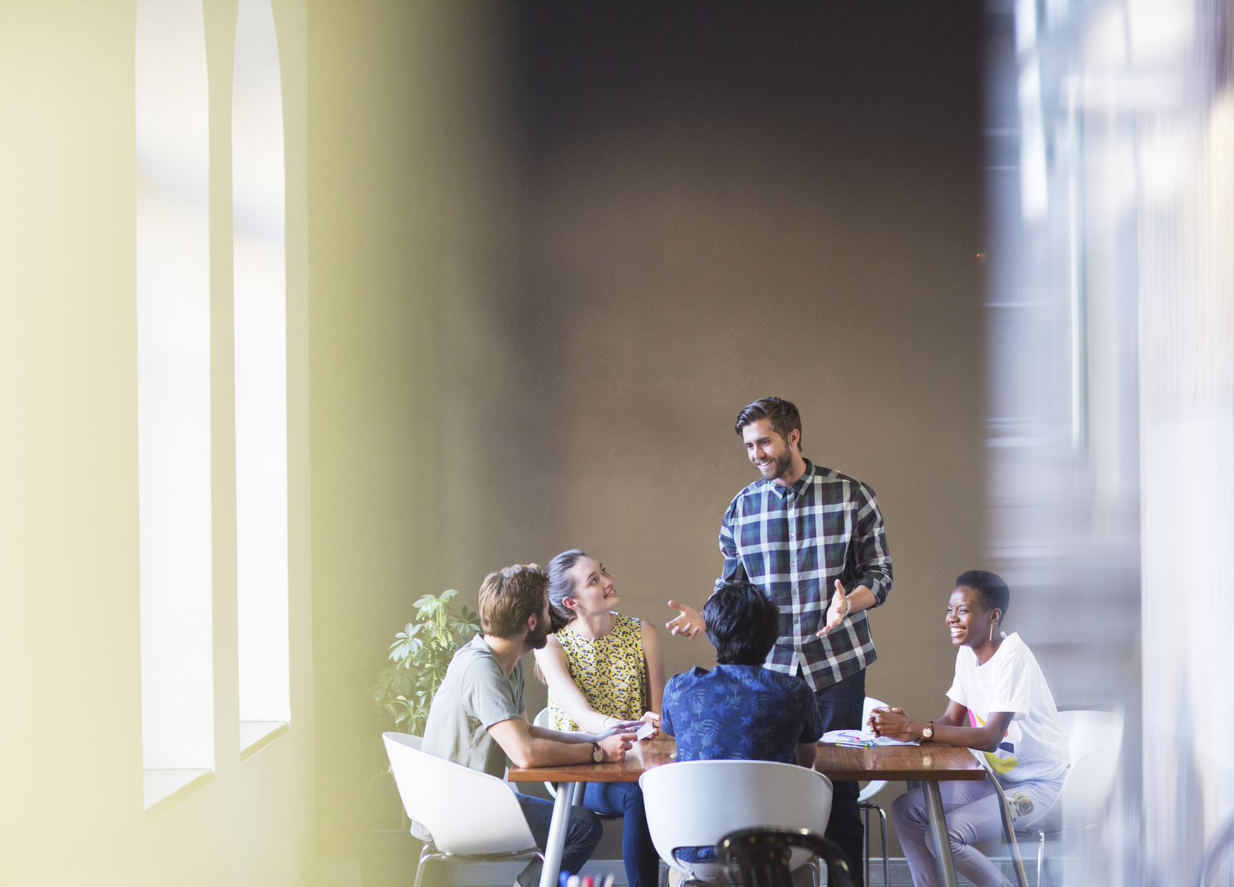 people having a meeting in a modern office
