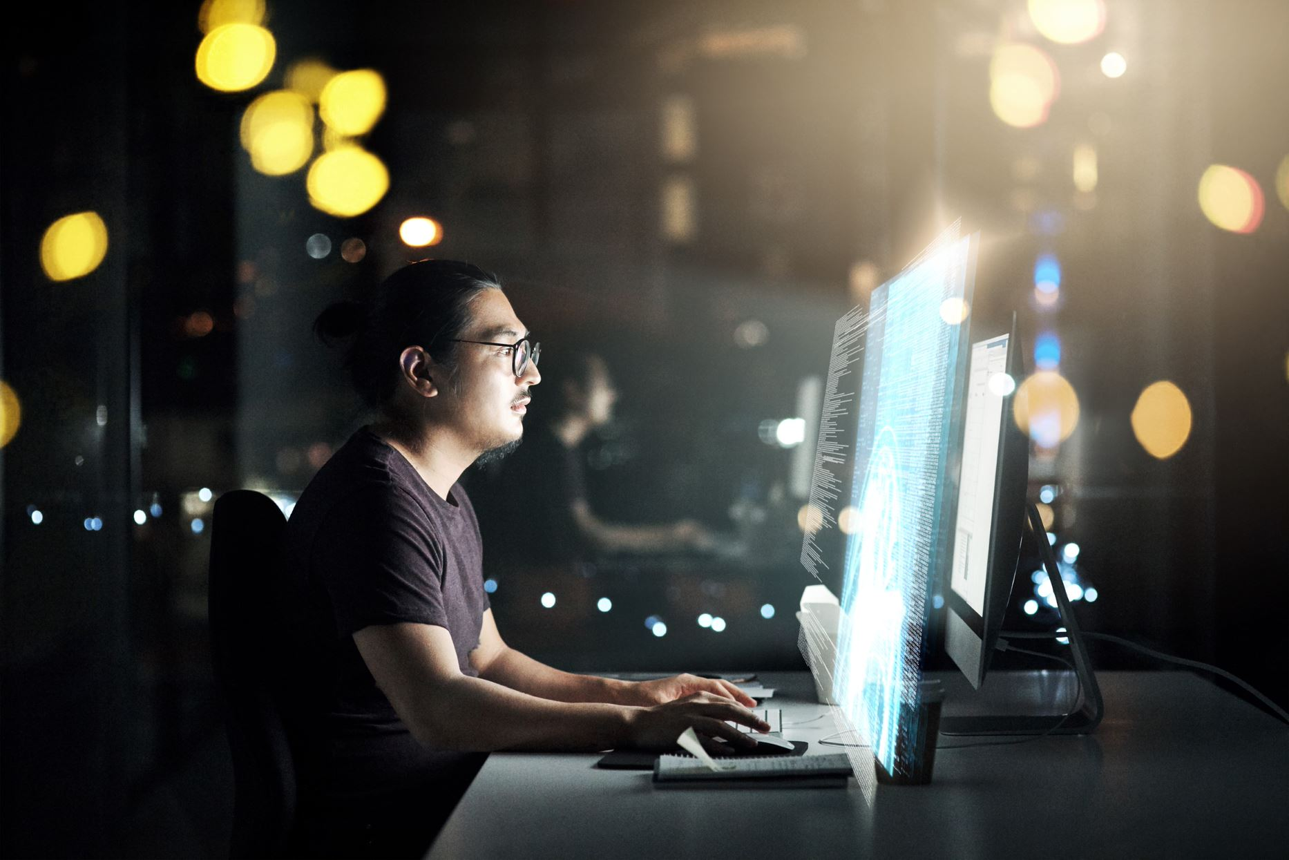 person working on the computer at night