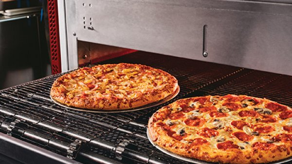 Domino's pizza in the oven