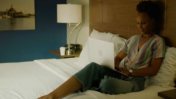 Woman on a laptop in a hotel room