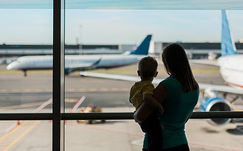 Woman and child looking at airplanes