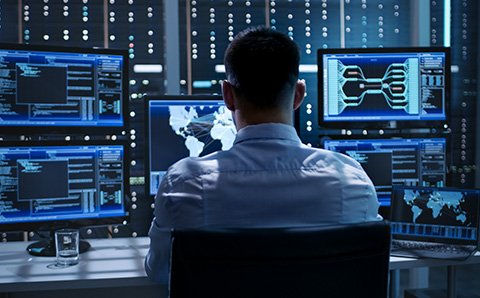 Man monitoring systems on a computer